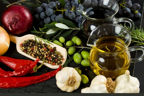 Extra virgin olive oil and balsamic vinegar with mediterranean food ingredients